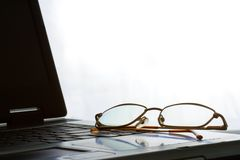 Laptop with laying glasses Royalty Free Stock Photo