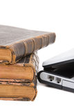 Laptop and legal books. Old legal books with modern laptop on white background Royalty Free Stock Photo