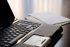Laptop and letters on a desk Royalty Free Stock Photography