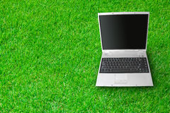 Laptop lies on a grass Stock Images