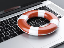 Laptop and Lifebuoy Stock Photography
