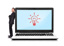 Laptop with lightbulb Stock Images