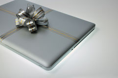 Laptop like a present Stock Photos