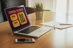 Laptop with on line cinema tickets purchase in the screen. Royalty Free Stock Images