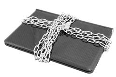 Laptop locked with chains. Laptop computer physically locked with chains and padlock Royalty Free Stock Image