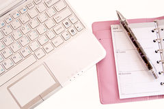 Laptop,  daily log and pen Stock Images