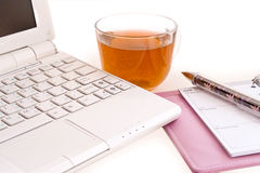 Laptop,  daily log,  pen and cup Stock Photos