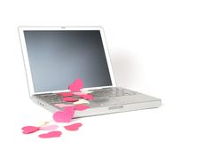 Laptop Love 6. Paper hearts on an open laptop Royalty Free Stock Photos
