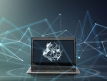 Laptop with low poly shape on screen. Technology and cyberspace concept - laptop computer with low poly shape on screen over dark gray background Vector Illustration