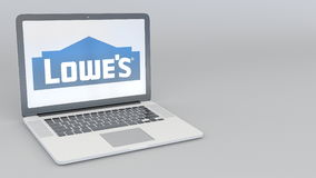 Laptop with Lowe`s logo. Computer technology conceptual editorial 3D rendering Royalty Free Stock Image
