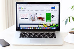 Laptop MacBook Pro Retina with site Ebay on the screen is on the. Simferopol, Russia - August 7, 2014: eBay the American company that provides services in the Stock Photo