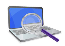 Laptop with magnifier Royalty Free Stock Images