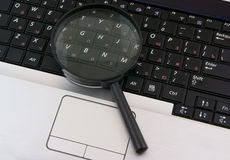 Laptop with a magnify glass. Close up Stock Photos