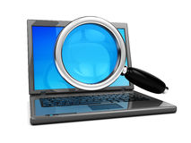 Laptop and magnify glass Stock Images