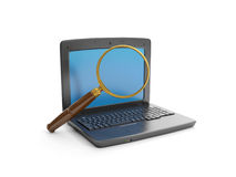 Laptop and a magnifying Stock Image