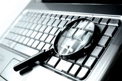 Laptop + Magnifying Glass Stock Images