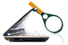 Laptop with magnifying glass. Small laptop with magnifying glass on white background. Concept of searching information or data Royalty Free Stock Photos