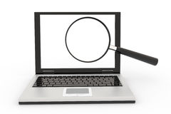 Laptop with a magnifying glass Stock Photography