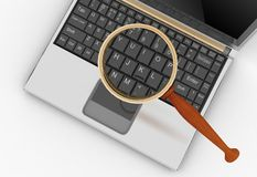 Laptop and magnifying glass. Royalty Free Stock Image