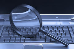 Laptop Magnifying glass Stock Photo