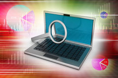 Laptop with magnifying glass Stock Photos
