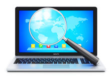Laptop and magnifying glass Royalty Free Stock Photography