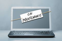 Laptop with maintenance note Royalty Free Stock Photography