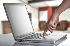 Laptop with man hand in loft studio Stock Photos