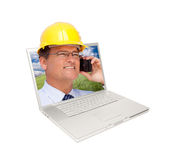 Laptop and Man with Hard Hat on Cell Phone Stock Image