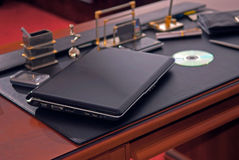 The laptop on a management table Royalty Free Stock Image