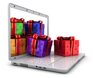 Laptop and many gifts Stock Image