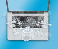 Laptop with map and people silhouettes teaming. Stock Images
