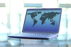 Laptop with a map of the world. Royalty Free Stock Images