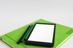 Laptop and marker pens are on the green weekly royalty free stock photos