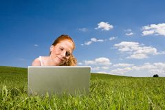With Laptop on meadow Stock Photo