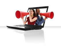 Laptop Megaphone. A black laptop computer with a red megaphone Royalty Free Stock Photography