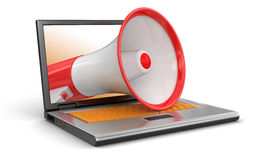 Laptop and Megaphone (clipping path included) Royalty Free Stock Photos