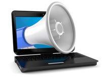 Laptop with megaphone Stock Photo