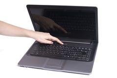 Laptop met hand Stock Foto's