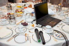 Laptop and microphones on restaurant table Royalty Free Stock Image