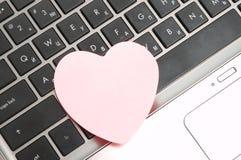 Laptop mit Aufkleber Lizenzfreie Stockbilder