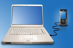 Laptop mobile connection. Laptop connected to a mobile phone Stock Photo