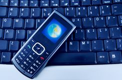 Laptop with Mobile Phone. Close up shot of mobile phone and a computer laptop Royalty Free Stock Photos