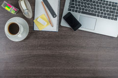 Laptop, Mobile Phone and coffee cup on work desk, Creativity Royalty Free Stock Photos