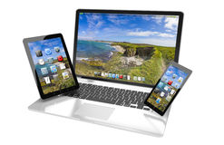 Laptop mobile phone and tablet connected to each other 3D render Stock Photo