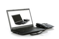 Laptop mobile and stationary phone Stock Images
