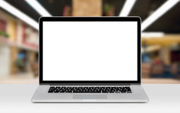 Laptop mockup with white blank display on the desk in office royalty free stock image