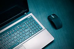 Laptop and modern flat mouse Stock Image