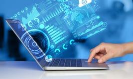 Laptop moderno com símbolos futuros da tecnologia Fotografia de Stock Royalty Free