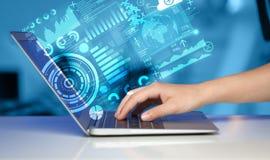Laptop moderno com símbolos futuros da tecnologia Fotos de Stock
